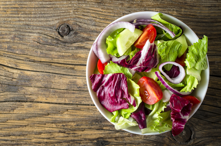 from above: Fresh vegetables salad on wooden table Stock Photo