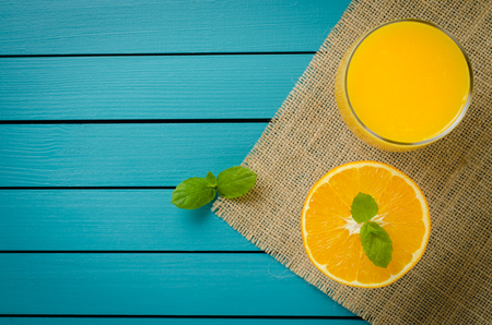 Fresh orange juice on wooden table