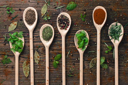green brown: Various spices on wooden spoons