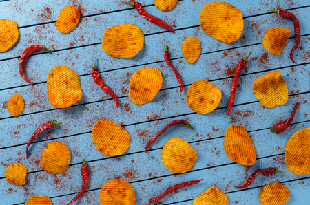 paprica: Crispy potato chips on blue wooden table