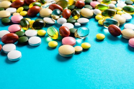 ecstasy pill: Colorful pills on blue background