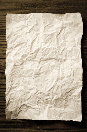 parchment: Sheet of crumpled paper on wooden table Stock Photo