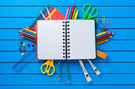 brush paint: School supplies on blue wooden table Stock Photo