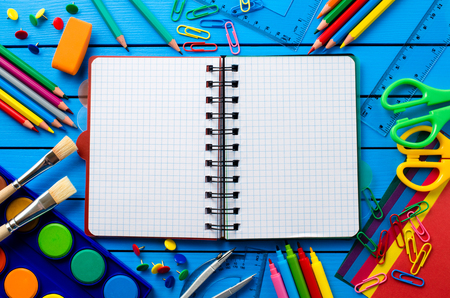 school table: School supplies on blue wooden table Stock Photo