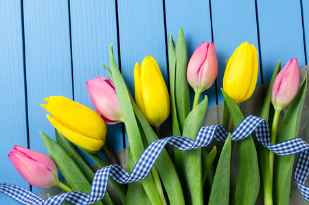 spring flower: Colorful tulips on blue wooden table Stock Photo
