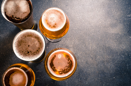 beer drinking: Beer glasses on a dark table Stock Photo