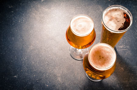 Beer glasses on a dark table 스톡 콘텐츠