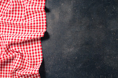 red tablecloth: Red tablecloth on dark table