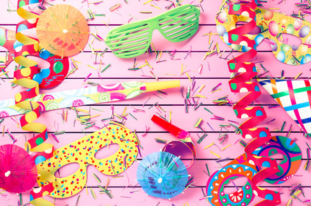 bright color: Colorful party decoration on pink background Stock Photo