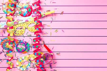 holiday celebration: Colorful party decoration on pink background Stock Photo