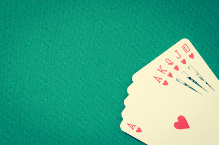 gamblers: Playing cards on green table