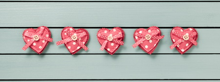 valentine card: Hearts on a wooden background