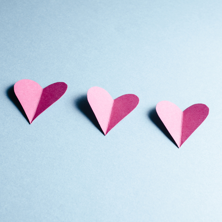 happy valentines day: Paper hearts on blue background Stock Photo