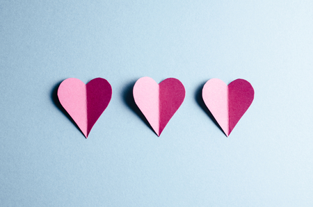 valentine card: Paper hearts on blue background Stock Photo