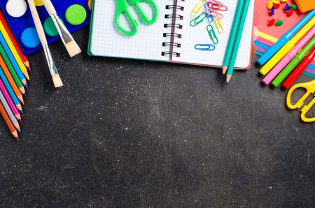 crayon  scissors: School supplies on a dark table Stock Photo