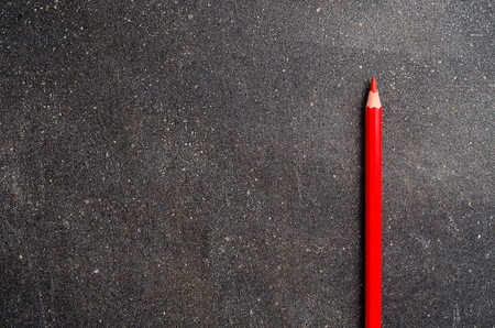 red pencil: Red pencil on dark table Stock Photo