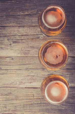beer pint: Overhead shot of beer glasses on an old wooden table