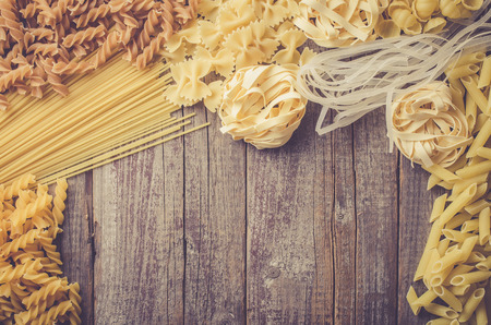 Mix of pasta on an old wooden table