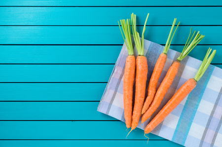 checkered tablecloth: Fresh carrots on checkered tablecloth Stock Photo