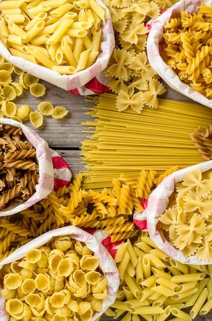 durum: Pasta in paper bag on wooden table