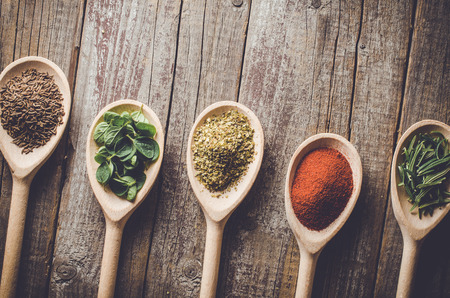 aromatic: Aromatic herbs and spices on wooden spoons