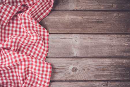 checkered tablecloth: Checkered tablecloth on wooden table