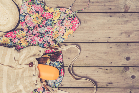 Womens summer clothes on wooden table
