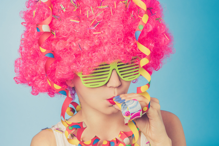 disguised: Portrait of beautiful woman in pink wig and green glasses