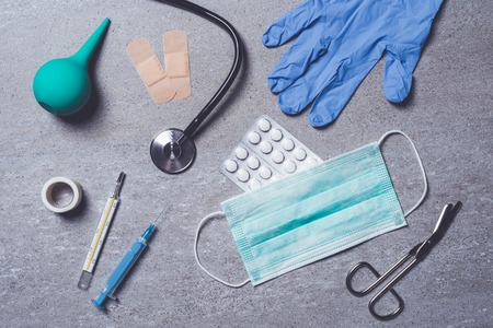 Medical supplies on stone background