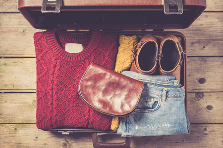 open suitcase: Open suitcase with casual female clothes