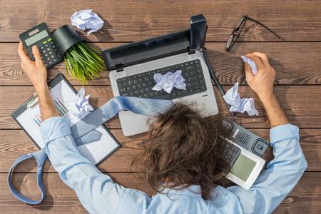 overworked: overworked businessman