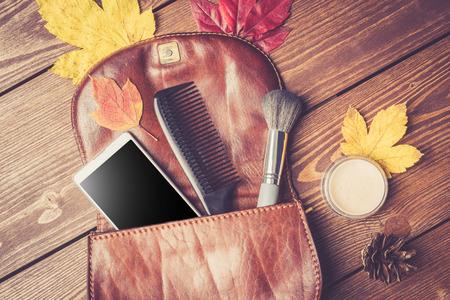 Open fashionable women's handbag on wooden background 写真素材 - 64257598