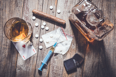 amphetamine: Hard drugs and alcohol on an old wooden table Stock Photo