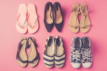 informal clothes: Collection of womens shoes on pink background Stock Photo