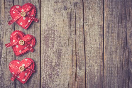 Red hearts on an old wooden table. Valentines Day background
