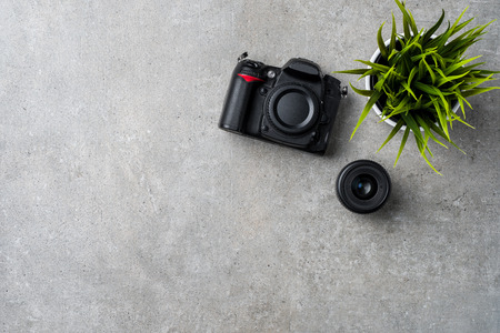 Modern camera on gray stone table Imagens