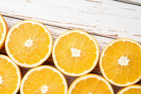 Half cut oranges background Stock Photo