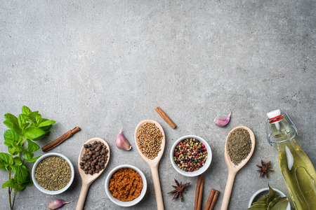 Fresh herbs and spices on gray stone table. Food background Stock Photo