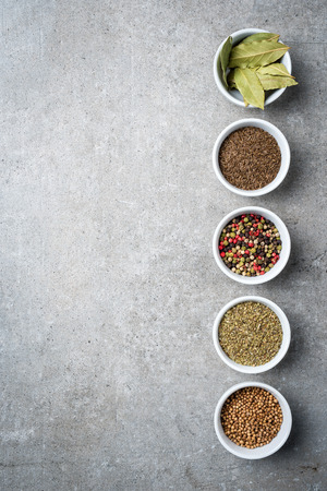 Herbs and spices in white bowls. Top view Stock Photo
