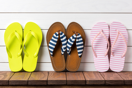 Flip flops on wooden background Stock Photo