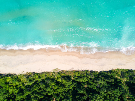 Aerial view of sandy beach and ocean Фото со стока