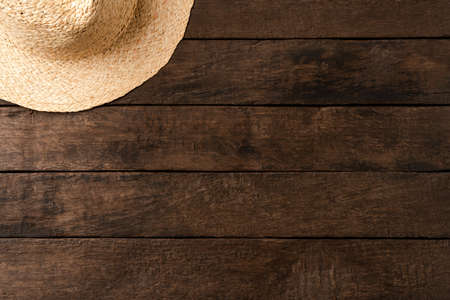 Straw hat on wooden table. Summer background