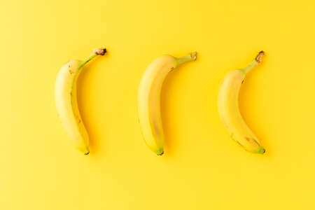 Fresh bananas on yellow background. Healthy snack. Close up