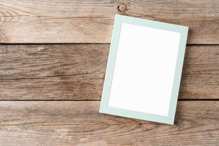 Empty picture frame on wooden background Reklamní fotografie