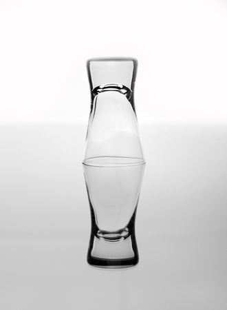 Inverted glass of vodka, symbol of alcohol problems photo
