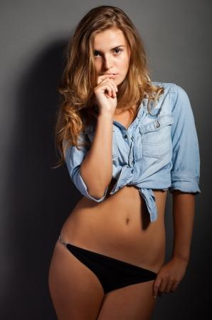 Hot natural woman body in denim jeans shirt jacket and panties photo