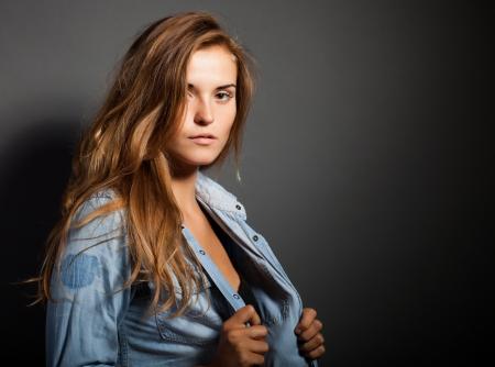 Portrait of natural woman in denim jeans shirt jacket photo
