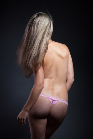 Beautiful woman with blond hair, back view photo