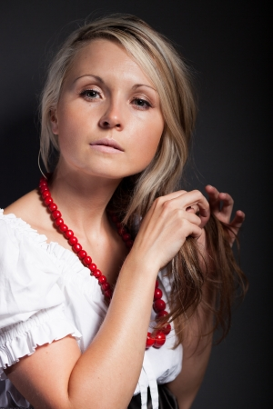 braiding: Folk woman in folklore clothes from Europe braiding a plait