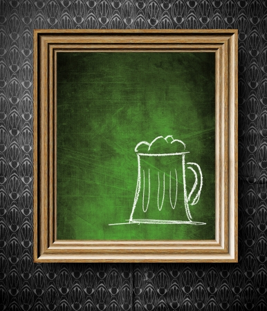 Beer menu with copy-space chalkboard in old wooden frame on vintage wall photo